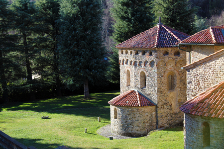 Romanesque baptistery and church surrounded by nature (basilica of Agliate medieval complex)