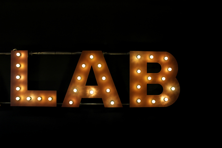 Lab writing made by switched on bulbs on a wall