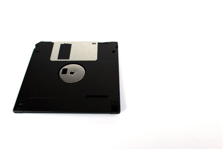 Black floppy disk isolated on white background (back side) perspective view
