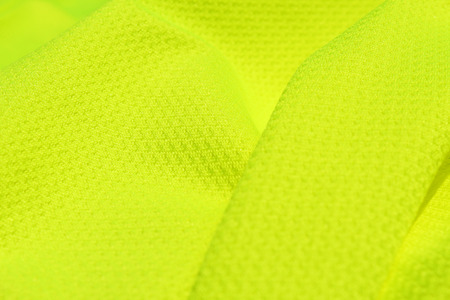 Light green textile with folds close up