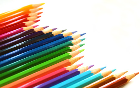 Multicolor bright color pencils diagonal wave on white background