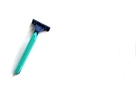 Green and blue plastic man new razor blade isolated on white background