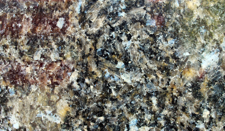 Black granite (marble) polished surface with large crystals seen in detail Stockfoto