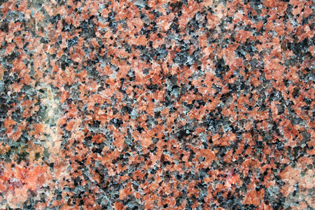 Red granite with large feldspar crystals polished surface Stockfoto