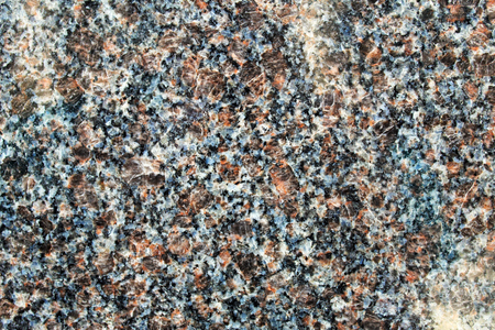 Dull red granite rock polished surface with large feldspar crystals Stockfoto
