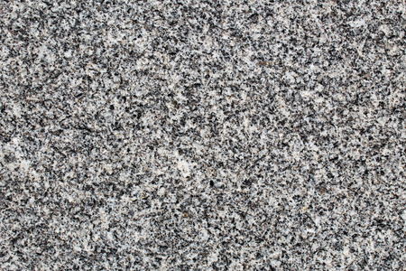 Fine-grained granite rock polished surface seen in detail