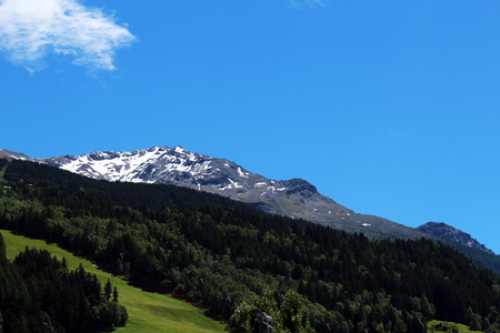Mountain top with snow in summer
