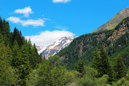 Mountain with alpine glacier at the end of a narrow valley Stockfoto