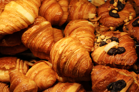 Close up of several freshly baked butter and chocolate croissants