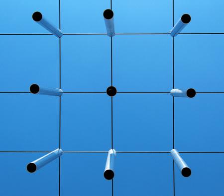 Metal rods (planks) against blue sky seen from below