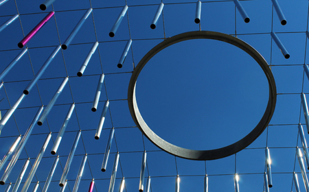 Metal rods (planks) and ring hoop hanging against blue sky - modern concept Stockfoto