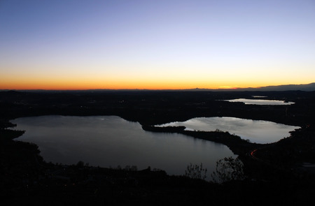 Annone lake at sunset from monte Barro (northern Lombardy) during a clear sky autumn night