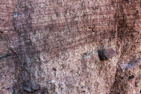 Coarse red sandstone rock seen in detail (close up) Stock Photo