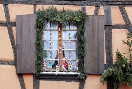 Old shutter window on a rural house facade with christmas decorations Stock Photo
