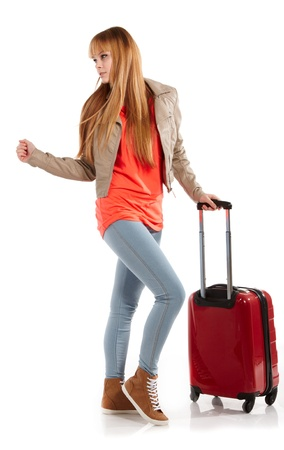 young girl with suitcase on white  photo
