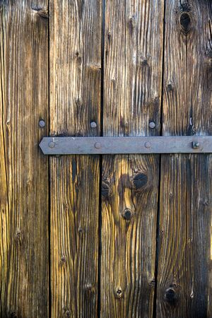 old corroded wooden door with metal fittings