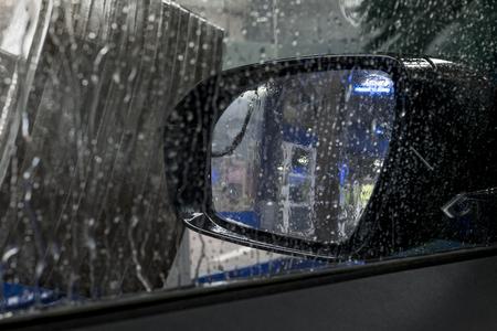 mirror on the water: Carwash through window showing mirror water Stock Photo