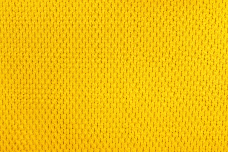 material: Yellow polyester nylon yellow sportswear shorts to created a textured background.  Stock Photo