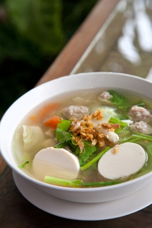 Thai food, famous tofu soup with vegetables and pork Stock Photo - 9997364