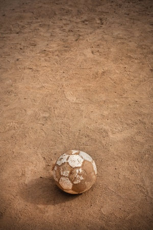 Old soccer ball on school playground. charity concept photo