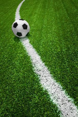 Ballon de soccer en ligne courbe verte champ
