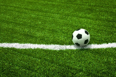 Soccer ball on green field photo