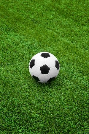 soccer ball: Soccer ball on green grass field Stock Photo