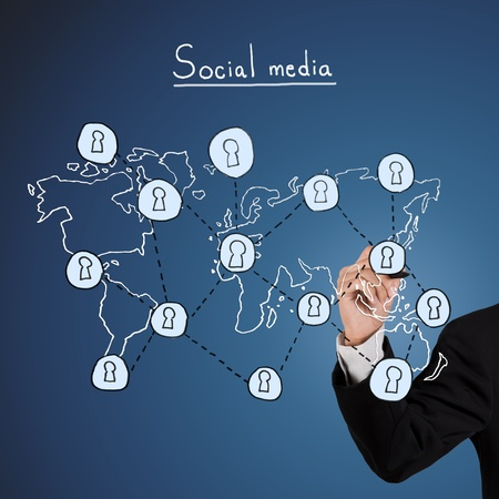 Businessman hand drawing a social network scheme Stock Photo - 11550715