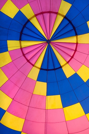 inside of Pink ,Blue and Yellow Hot air balloon  photo