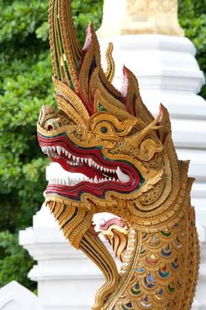 naga china: close up of naga head statue protecting the entrance to Thai temple Stock Photo