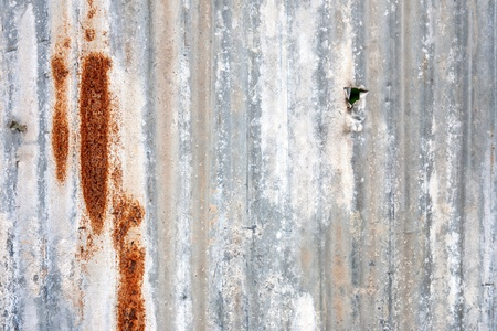 A rusty corrugated iron metal fence close up Stock Photo
