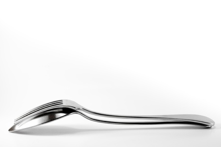 Spoon and fork isolated on white with space for text.  photo