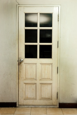 Old room interior background with old wooden white door and tile  photo