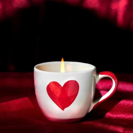 flame like: Romantic candle light in love cup for special valentine day Stock Photo