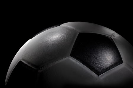 half ball: Half Planet Soccer ball in spot light on black background