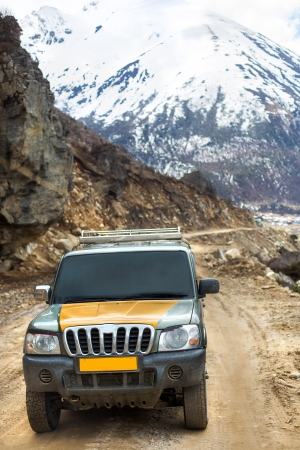 Adventure car on the way to Chopta Valley , Sikkim with snow mountain background Stock Photo - 13613437