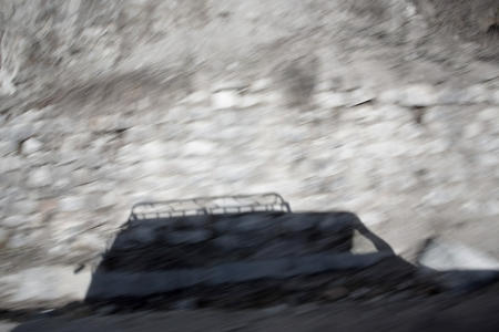 Shadow of 4x4 Truck driving trough mountain Stock Photo