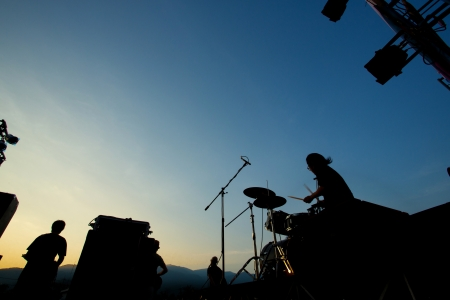 Silhouette of music band on stage