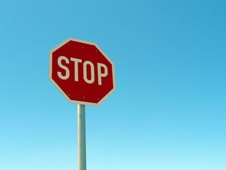 Road stop sign against a blue sky. Stock Photo - 642689