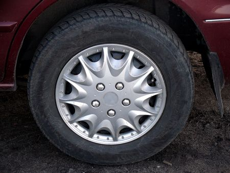installed: Wheel installed on car with hubcap on disk Stock Photo