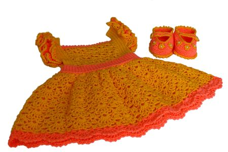 Baby, crochet, baby's bootees with the dress.
