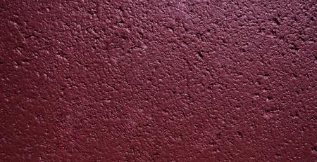 Dark maroon cinder block wall texture colorful