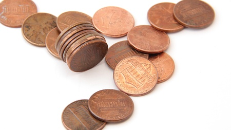 Stack of pennies with others on white isolated photo