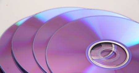 toppled: Toppled pile of DVDs or CDs