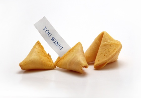 good fortune: Two fortune cookies - one opened, with caption YOU WIN!!!