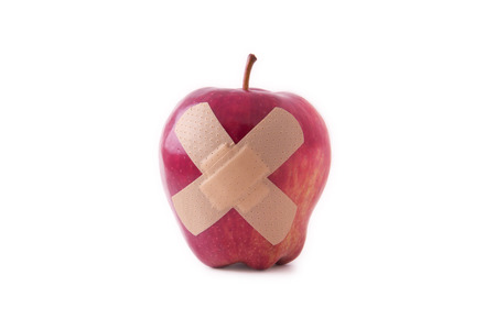 Isolated apple with plaster photo