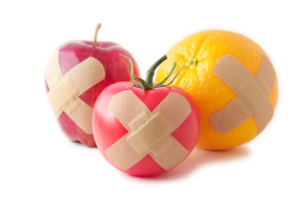 Bandaged apple, tomato, and orange to promote healthy living