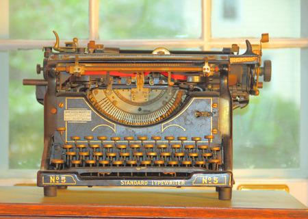 An old vintage typewriter on a desk  Editorial