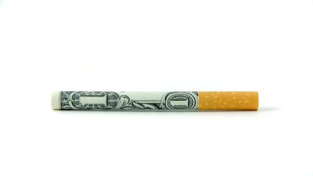 A single cigarette made from a dollar bill Foto de archivo
