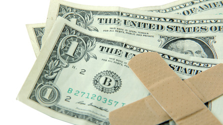 fiscal cliff: Dollar bills with band-aids = economic hardship